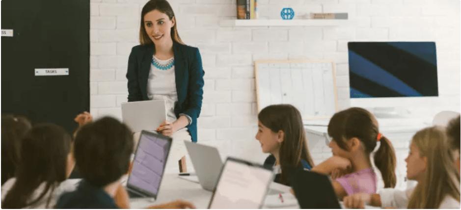 Teacher teaching coding to kids